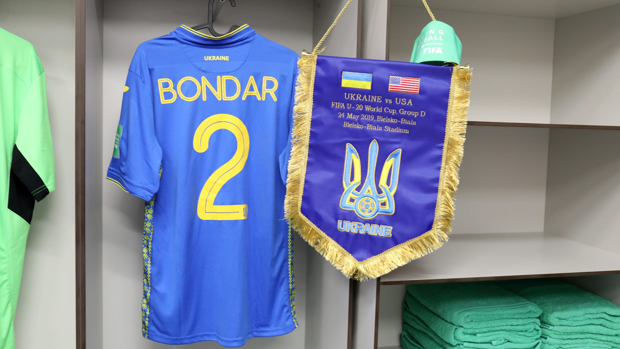 The shirt of Valerii Bondar of Ukraine is seen with a pennant inside the Ukraine dressing room