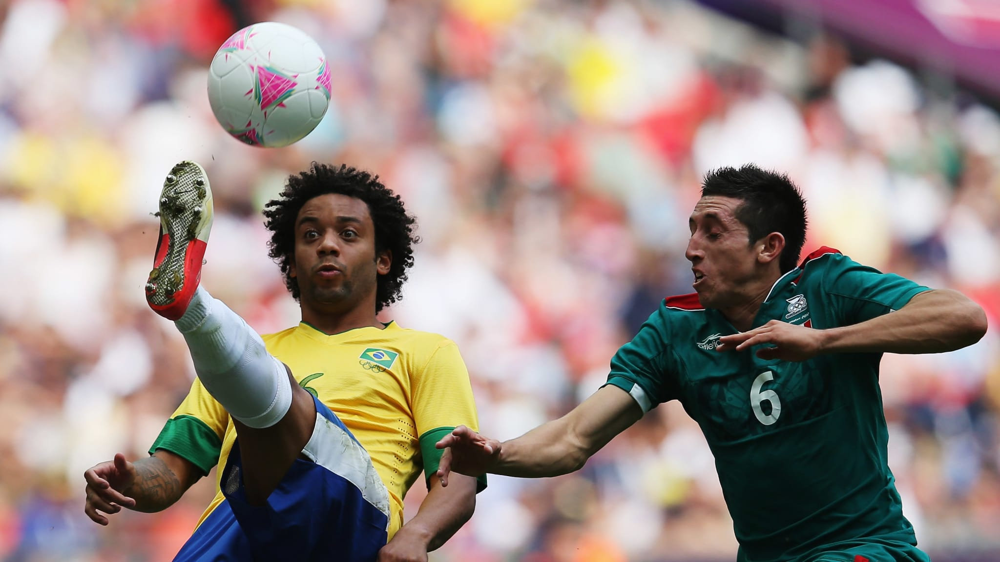 Hector Herrera of Mexico and Marcelo of Brazil in 2012  Men's Olympic Football Final - Brazil v Mexico