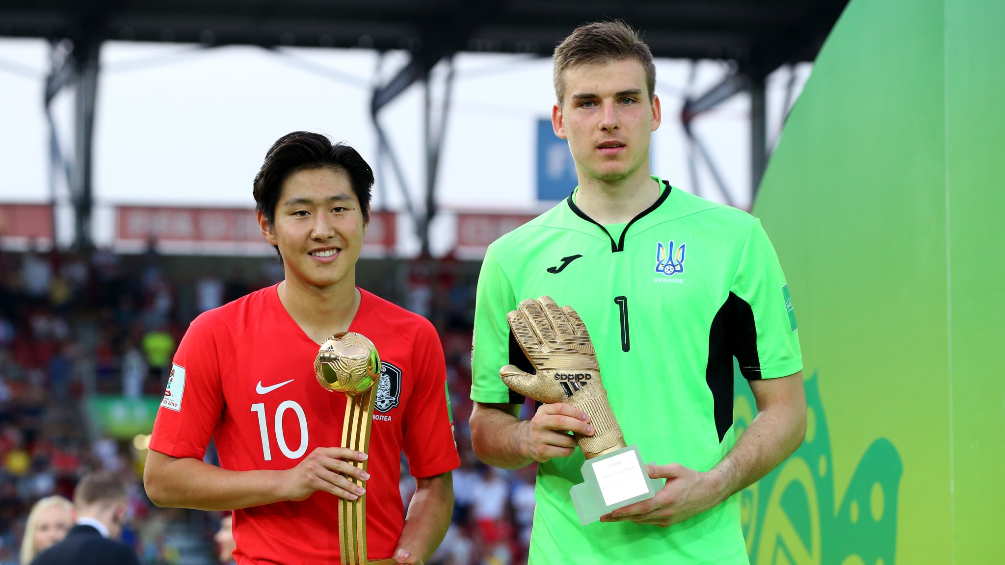 Kangin Lee of Korea Republic (L) with the Adidas Golden Ball award and Andriy Lunin of Ukraine