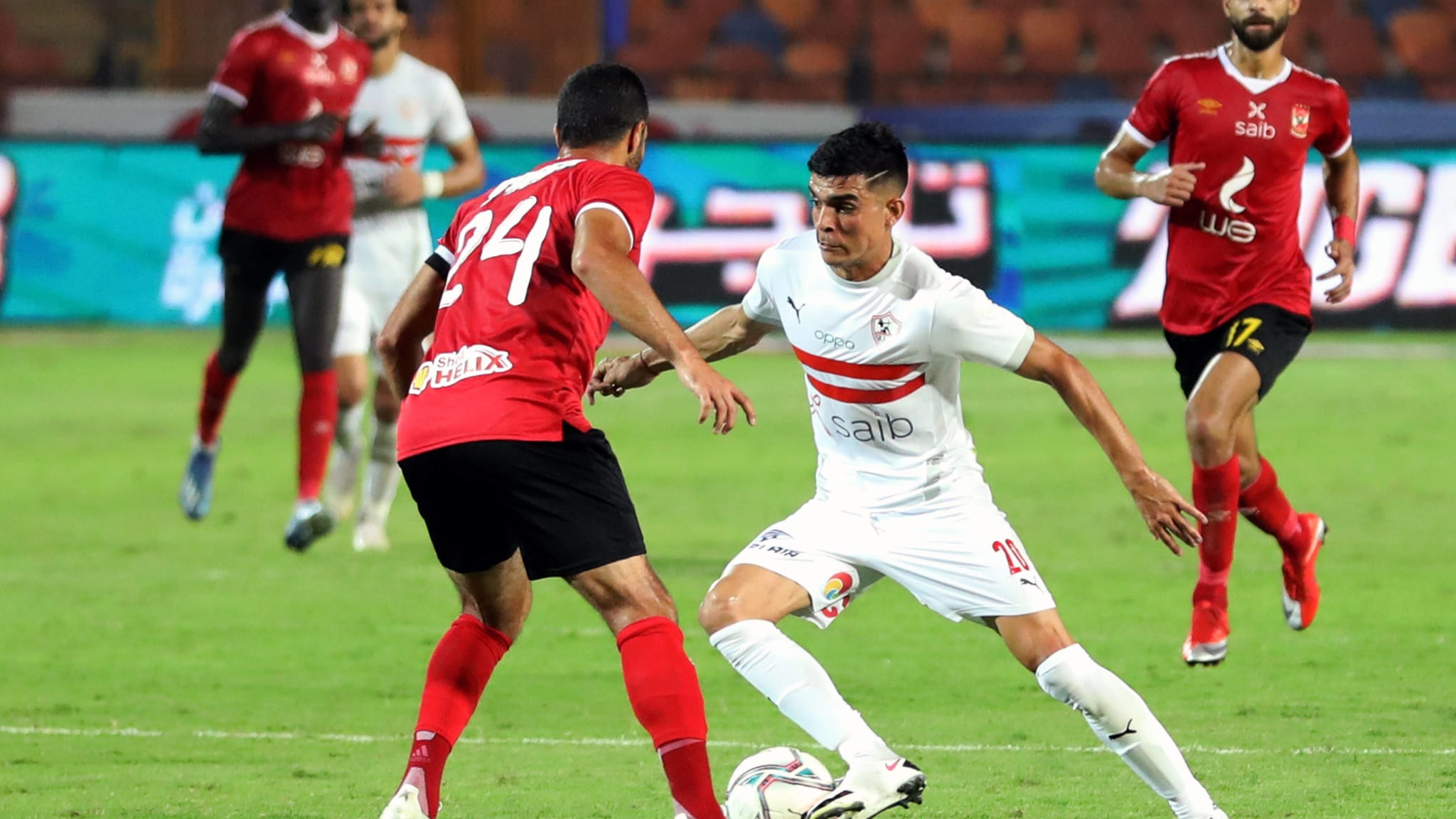 Achraf Bencharki of Zamalek competes with Ahmed Fathy of Al-Ahly