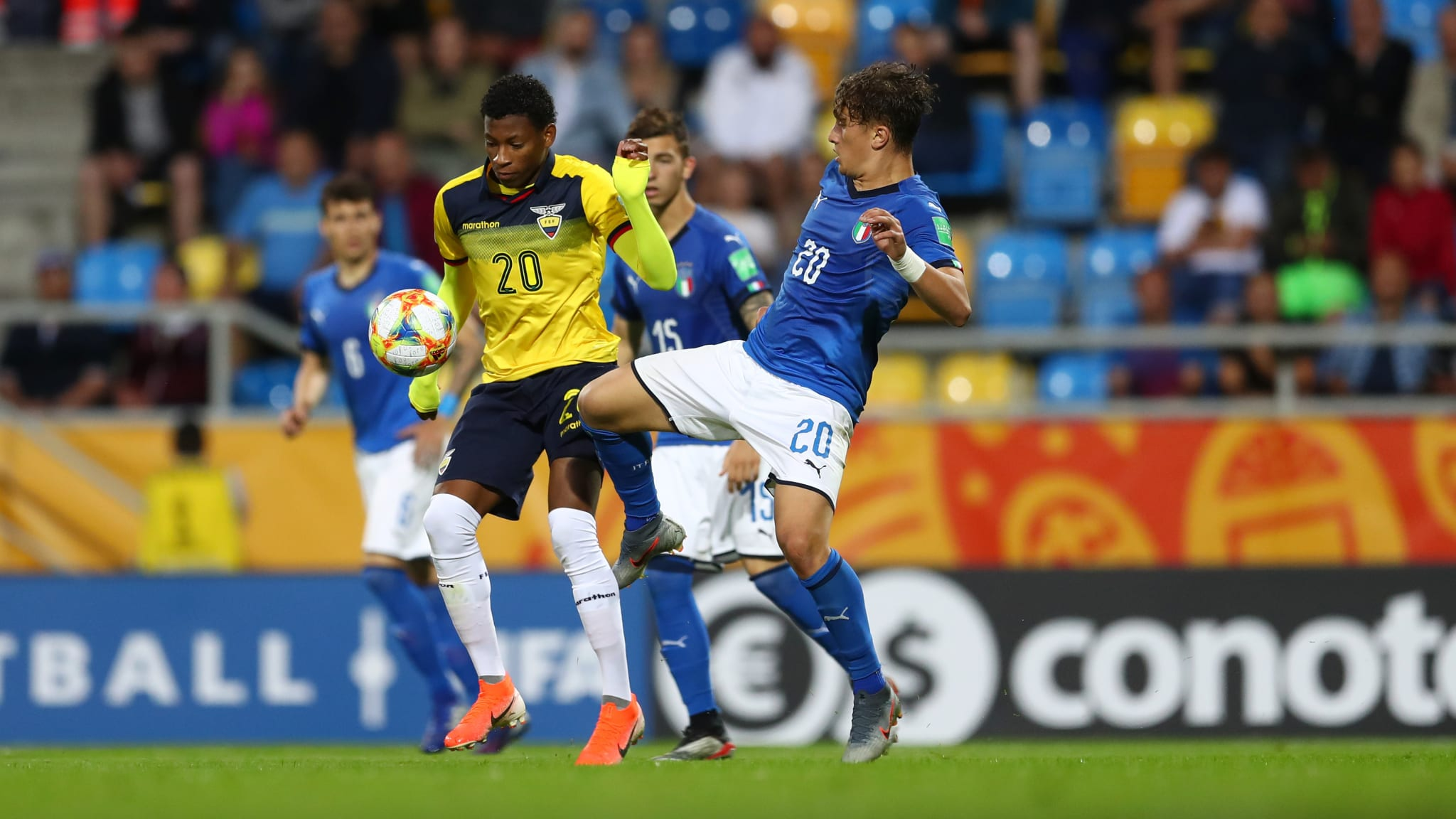 Salvatore Esposito of Italy battles for possession with Gonzalo Plata of Ecuador