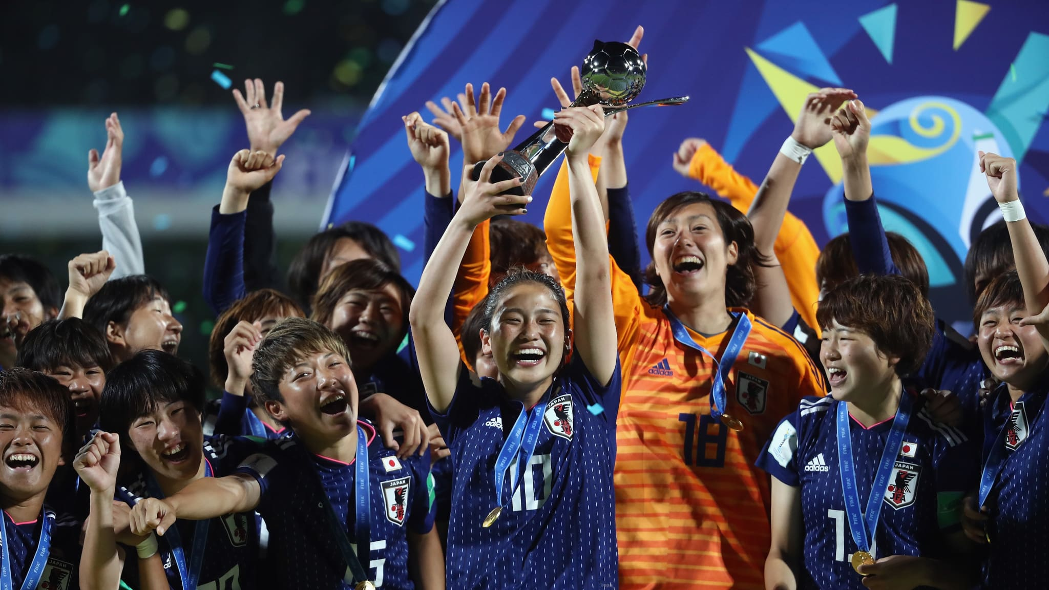 Fuka Nagano of Japan lifts the trophy with teammates after victory