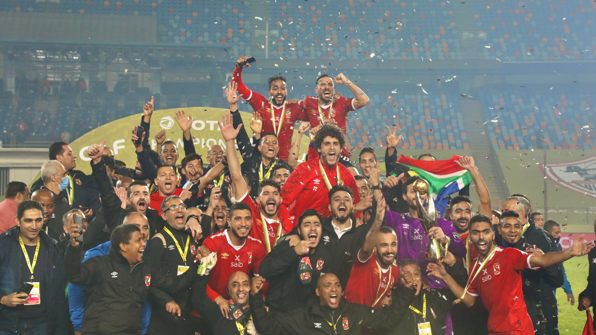 Al Ahly players celebrate with the trophy after winning the CAF champions league final against Zamalek