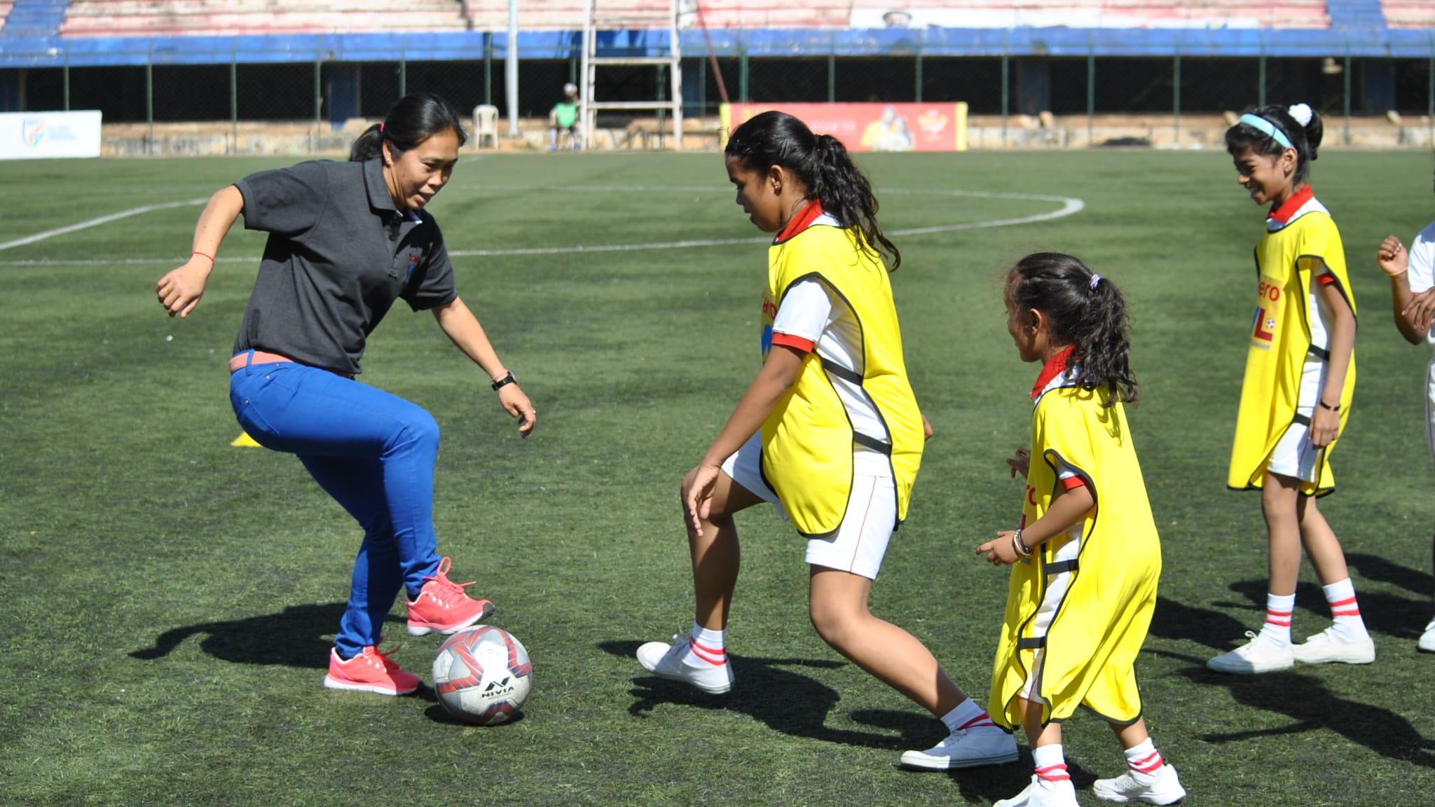 Oinam Bembem Devi coaches children in India.
