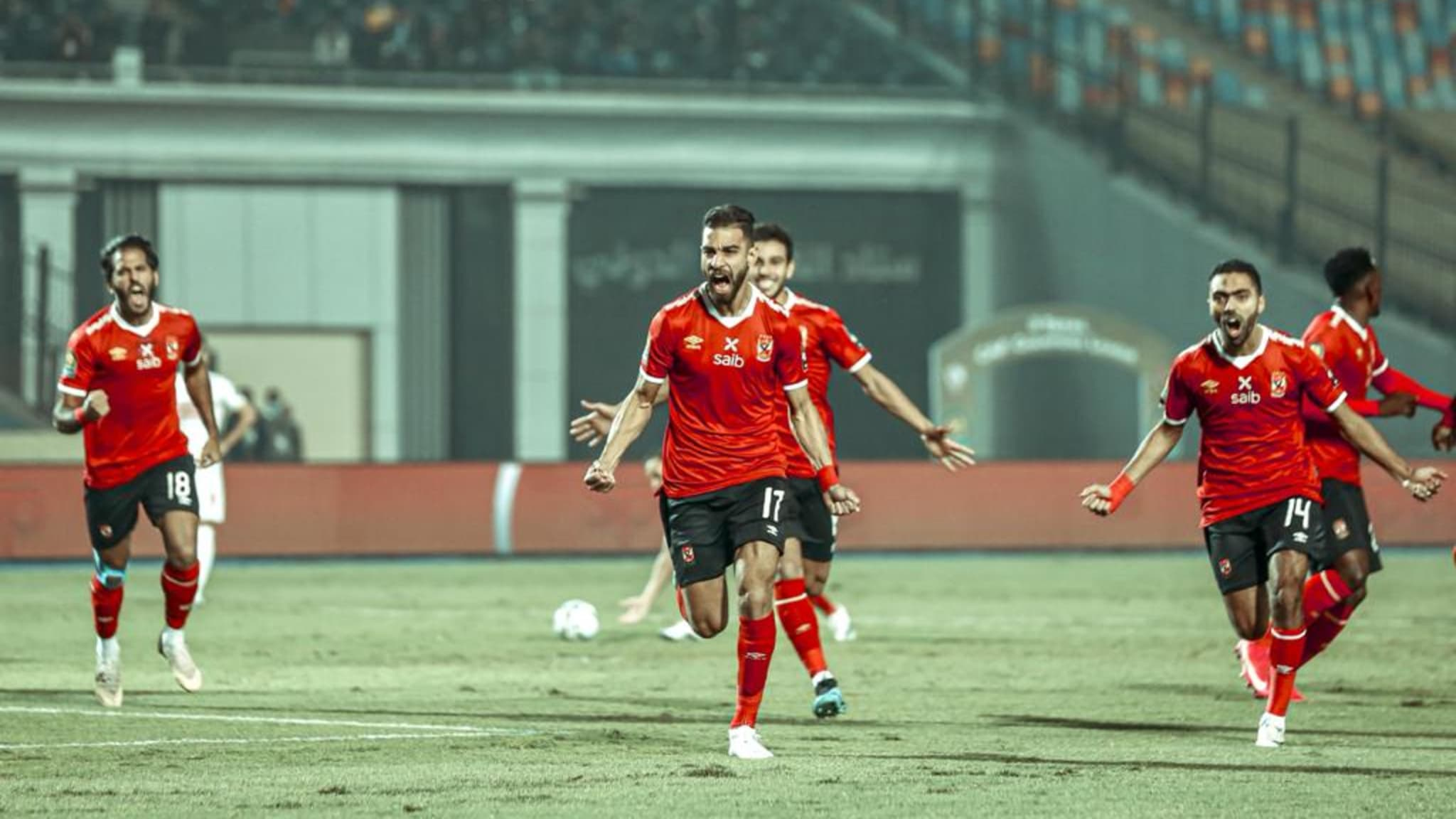 Al Ahly players celebrate their goal against Zamalek
