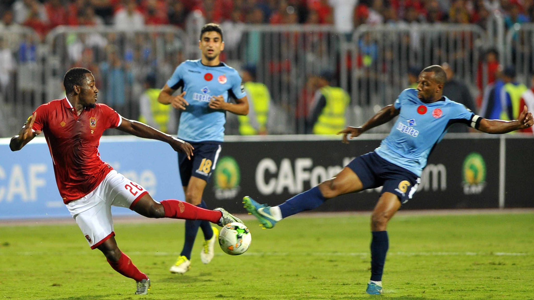 Wydad's midfielder Brahim Nakach (R) vies for the ball with Ahly s forward Junior Ajayi