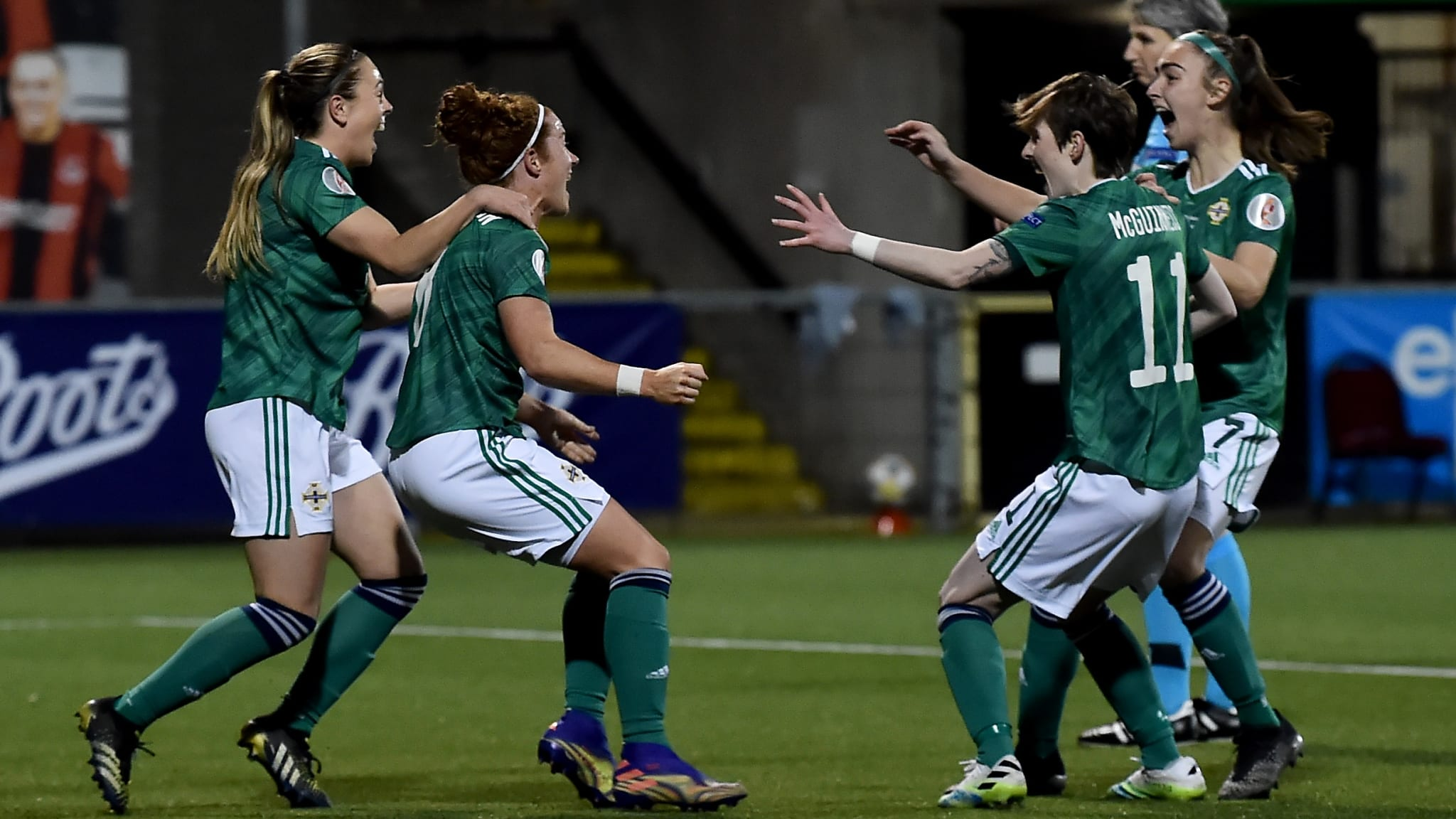 Marissa Callaghan of Northern Ireland celebrates with teammates after scoring their team's first goal during the UEFA Women's Euro 2022 Play-off match between Northern Ireland and Ukraine at Seaview on April 13, 2021 in Belfast, Northern Ireland.