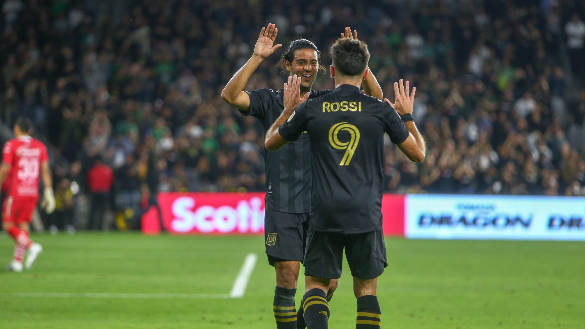 Carlos Vela and Diego Rossi of LAFC celebrate in the Round of 16 match against Club Leon in the Concacaf Champions League