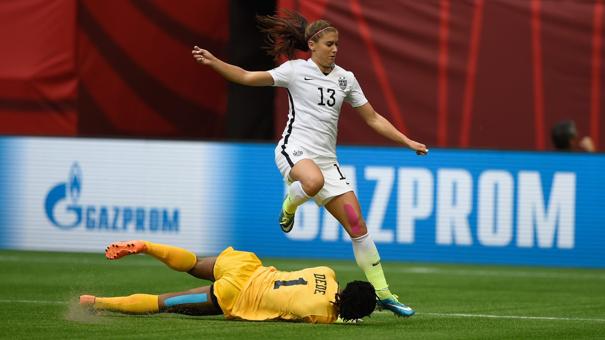 Precious Dede of Nigeria makes a save at the feet of Alex Morgan of USA during the FIFA Women's World Cup 2015 Group D match between Nigeria and USA at BC Place Stadium on June 16, 2015 in Vancouver, Canada.
