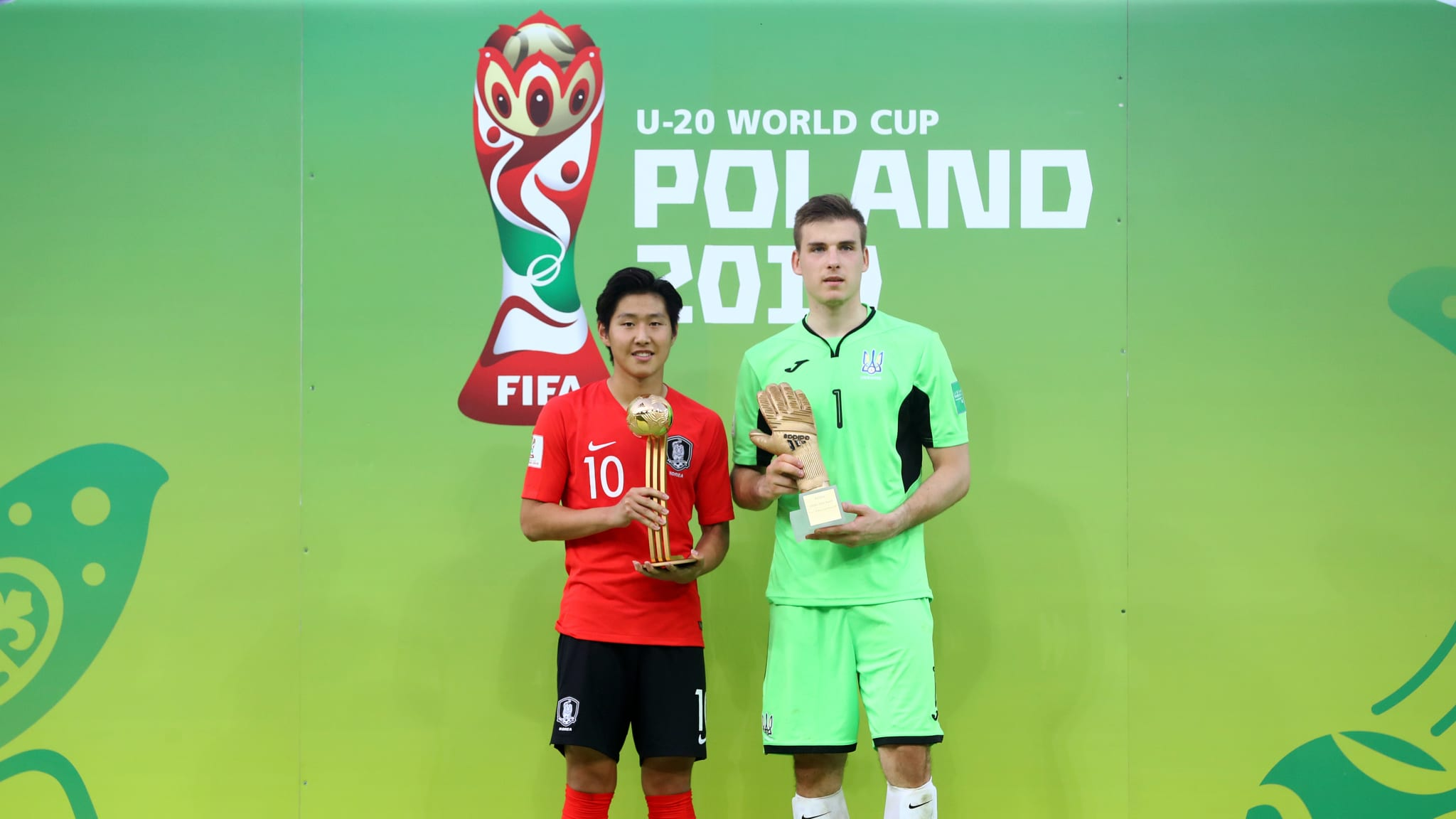 Kangin Lee of Korea Republic poses with his Adidas Golden Ball Award and Andriy Lunin of Ukraine poses with his Adidas Golden Glove Award
