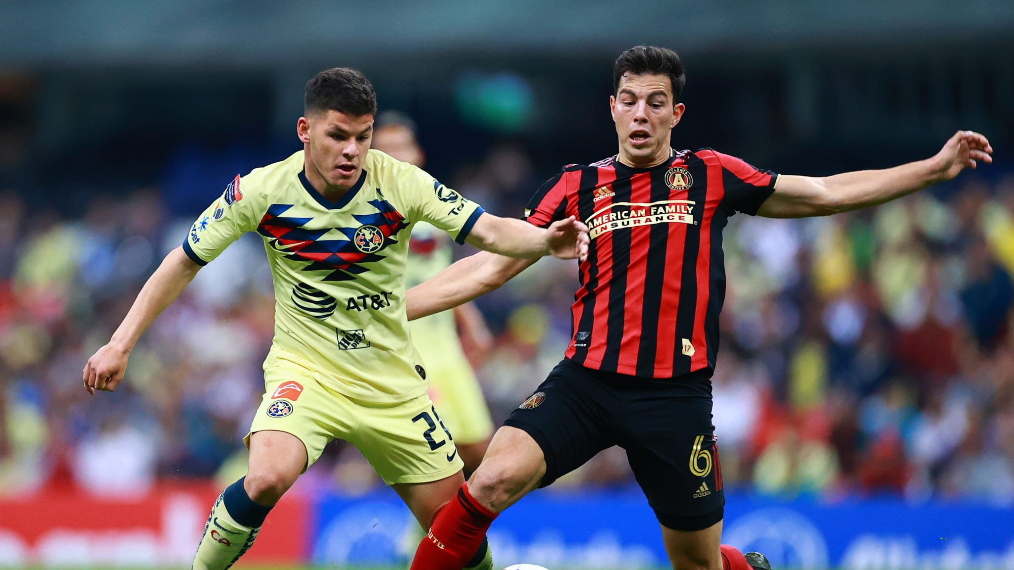 Richard Sanchez of America struggles for the ball against Fernando Meza of Atlanta United