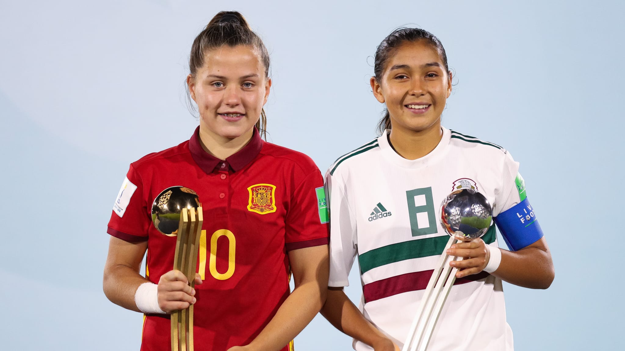Claudia Pina (L) of Spain and Nicole Perez of Mexico poses with adidas Golden and Silver Ball Award