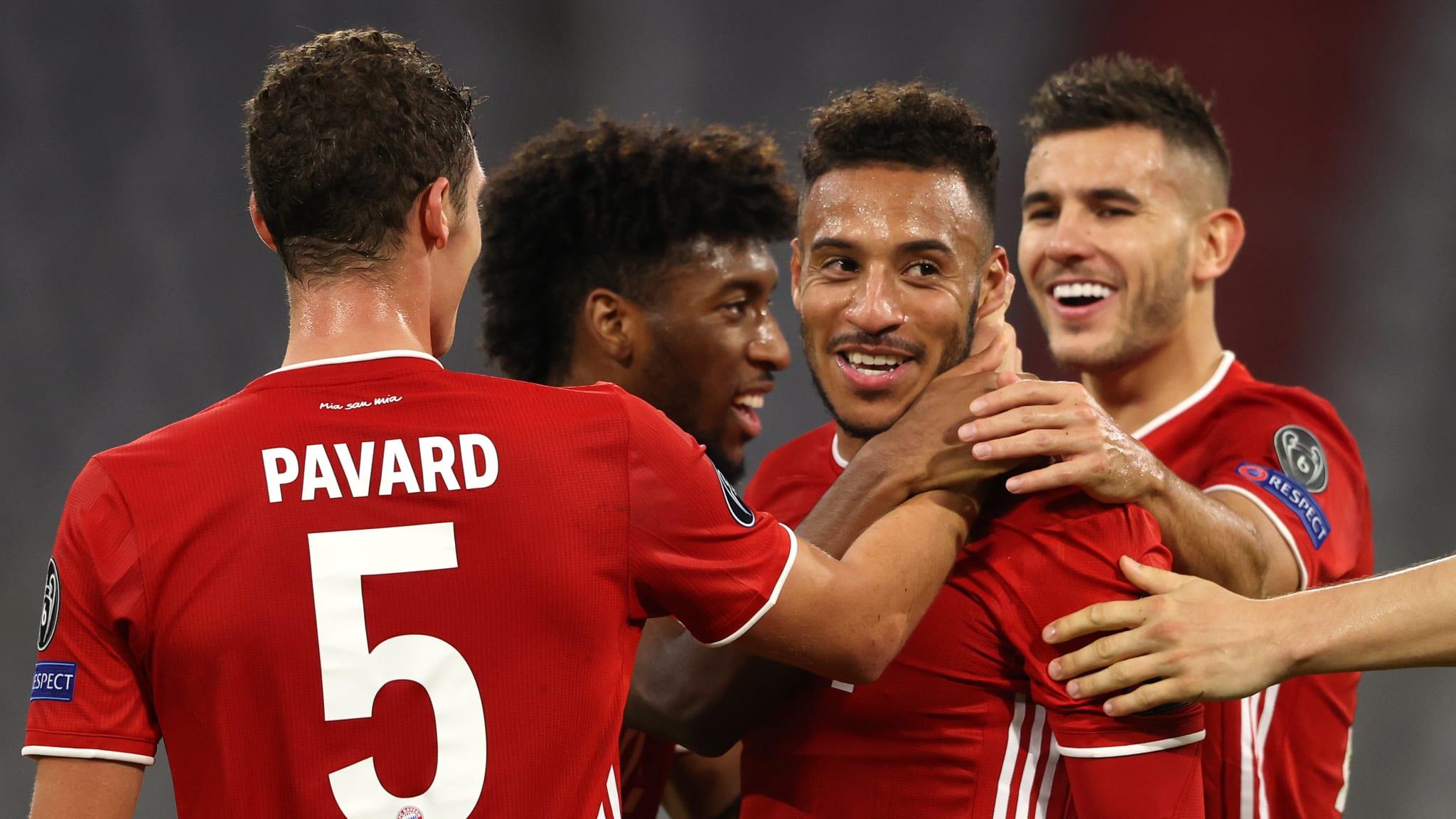 Corentin Tolisso of Bayern Munich celebrates with teammates
