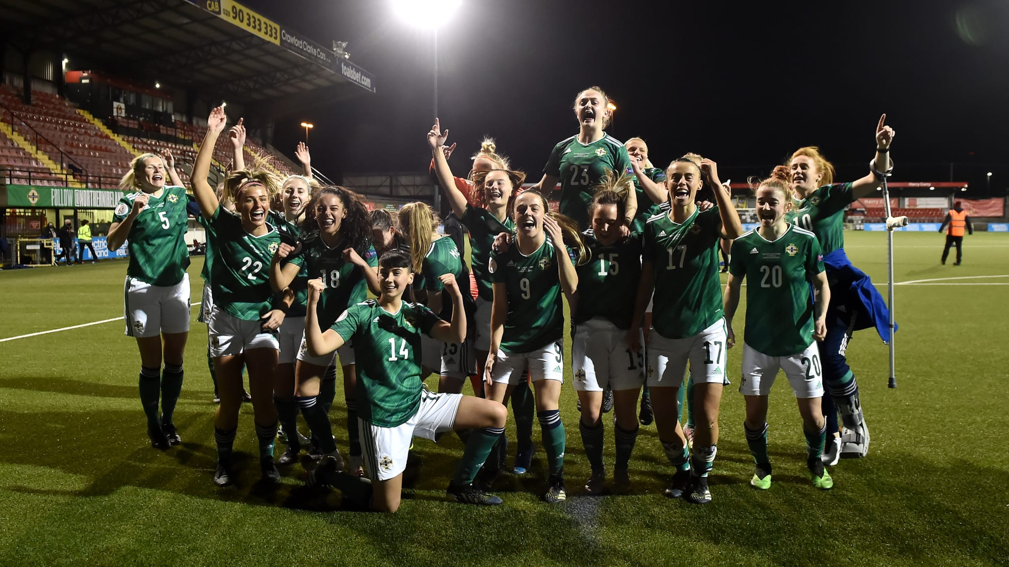 Northern Ireland players celebrate victory in the UEFA Women's Euro 2022 Play-off match between Northern Ireland and Ukraine at Seaview on April 13, 2021 in Belfast, Northern Ireland.