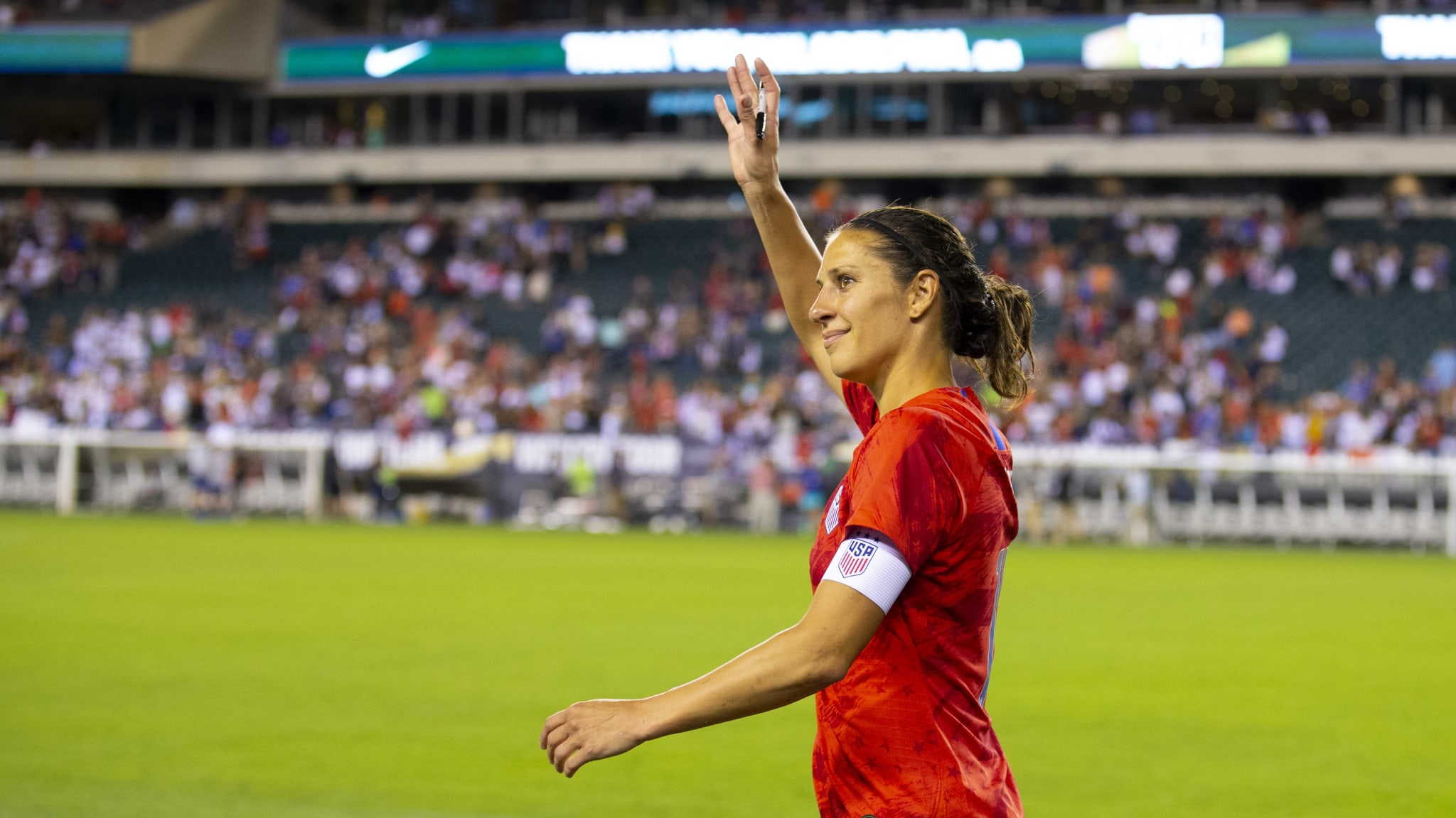 USA's Carli Lloyd salutes the supporters