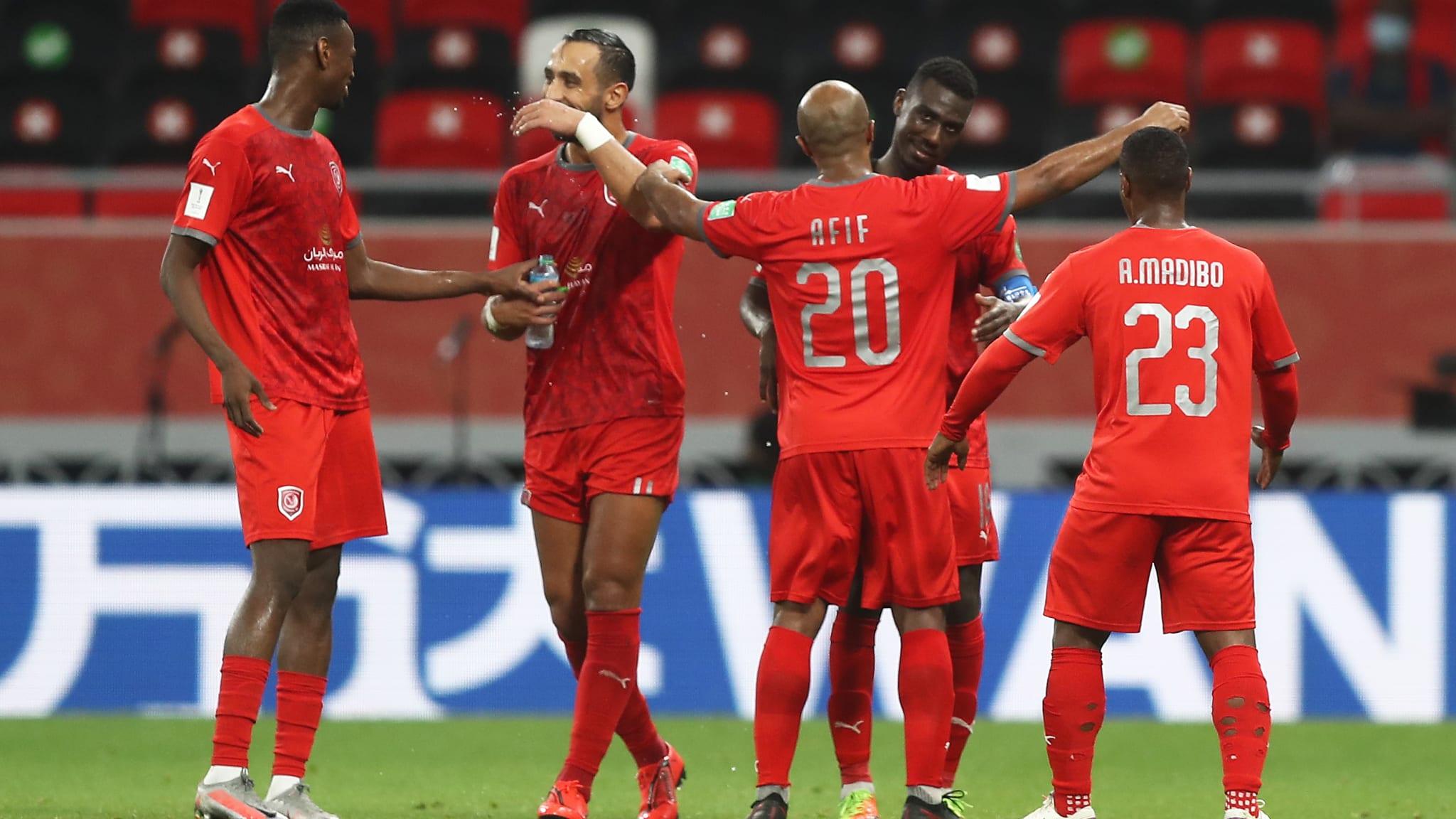 Almoez Ali of Al Duhail SC celebrates with teammate Ali Afif