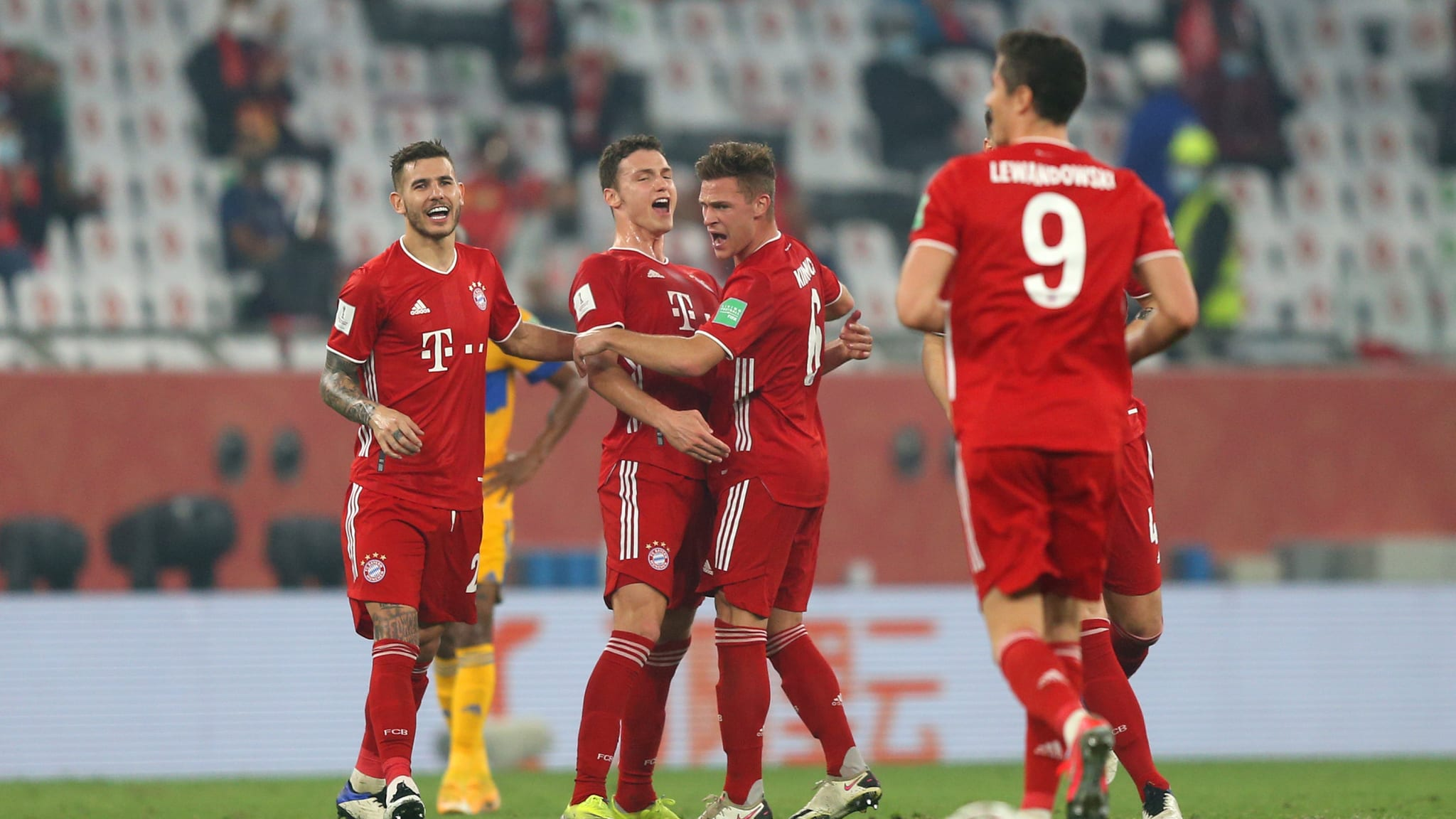Benjamin Pavard of FC Bayern Muenchen celebrates with teammates Lucas Hernandez and Joshua Kimmich