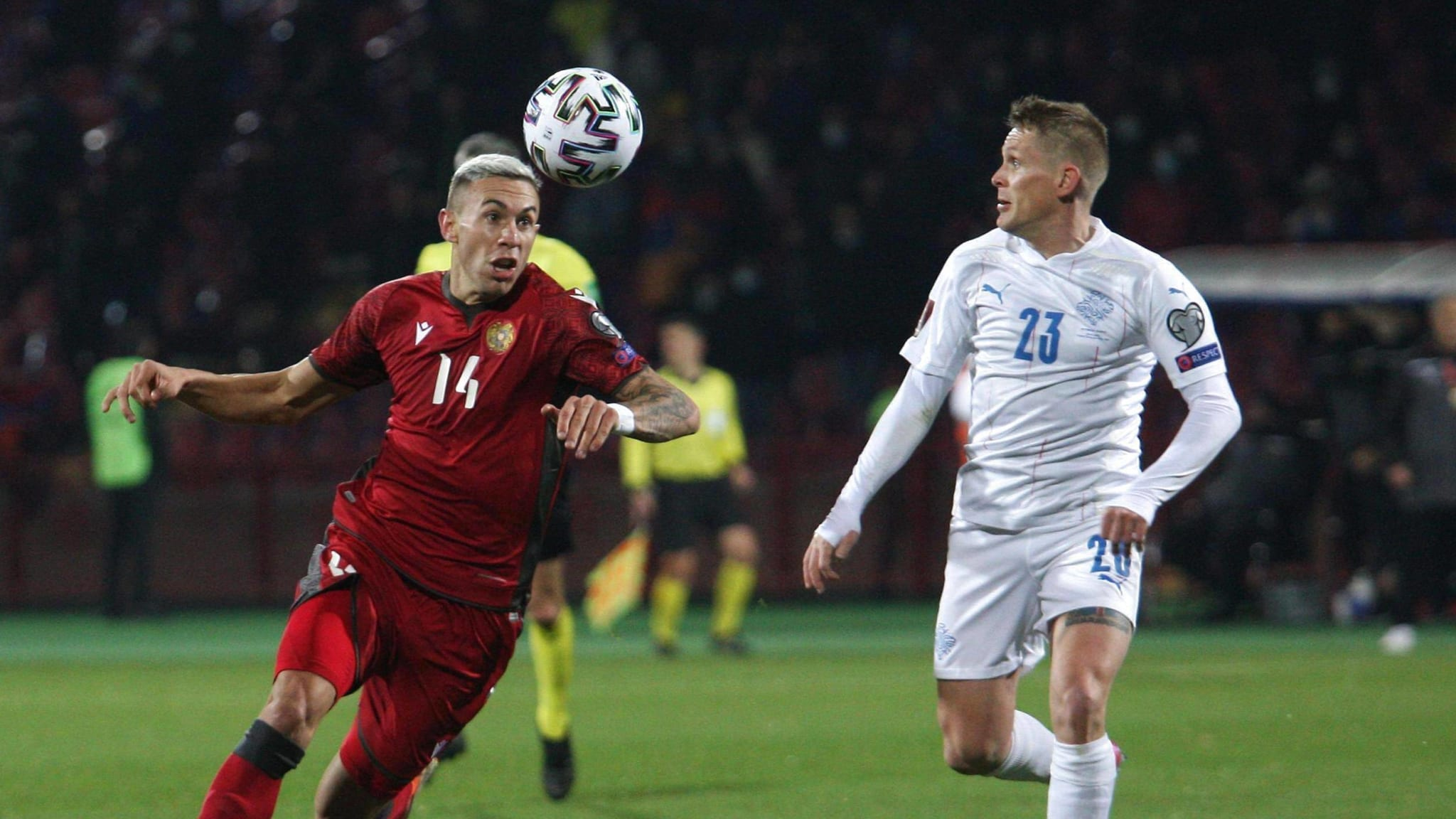 Norberto Briasco (L) of Armenia vies with Ari Skulason of Iceland during the 2022 FIFA World Cup, WM, Weltmeisterschaft, Fussball qualification match between Armenia and Iceland in Yerevan, Armenia, March 28, 2021.