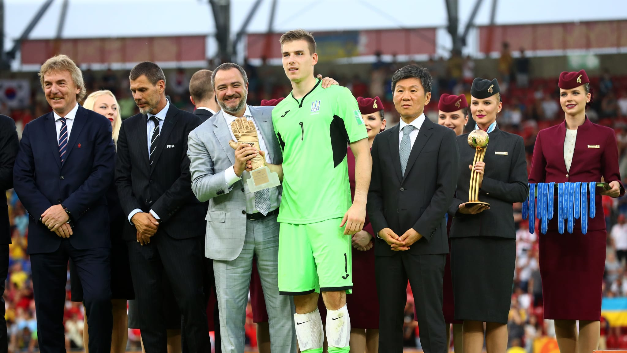 Andriy Pavelko, President of the Football Federation of Ukraine presents Andriy Lunin of Ukraine with the Golden Glove Award